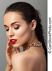 Beauty portrait of young aristocratic woman with red lips...