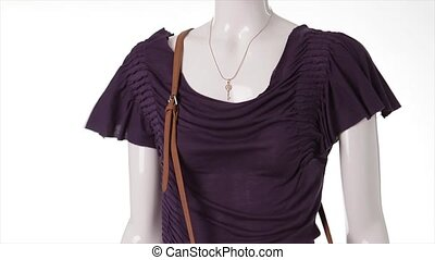Purple t-shirt in the wind Dark purple garment on mannequin...