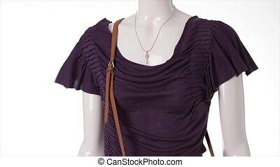 Purple t-shirt in the wind Dark purple garment on mannequin...