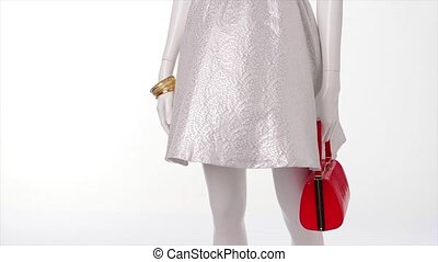White dress in the wind. Red handbag and white dress....