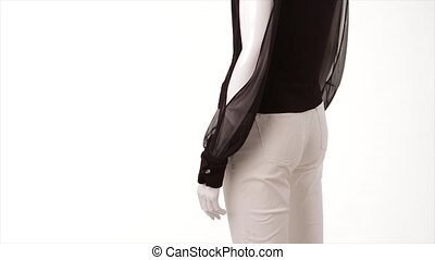 Mannequin in dark blouse turning. Transparent blouse on...