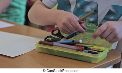 Child choose a pencils at home