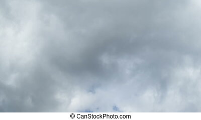 Storm Clouds Moving in the Blue Sky. White, rain, gray,...