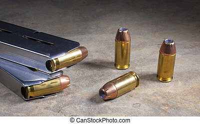 Cartridges for a semi automatic handgun loaded with hollow...