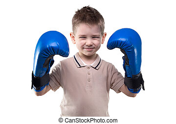 Cute smiling little boy with boxing gloves