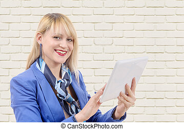 beautiful modern businesswoman with blue suit, holding a...