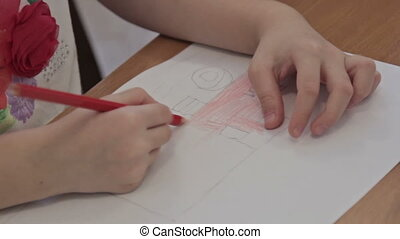 Kids drawing at kindergarten by pencils