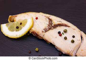 Slice of swordfish on a slate floor close up view