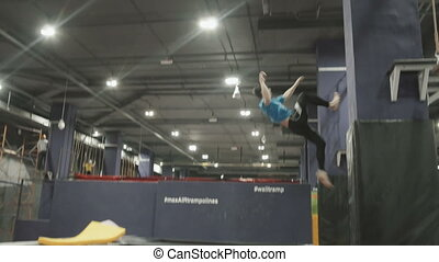Professional gymnast doing trcks on trampoline. Going on...