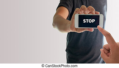 a man using hand holding the smartphone with text stop on...