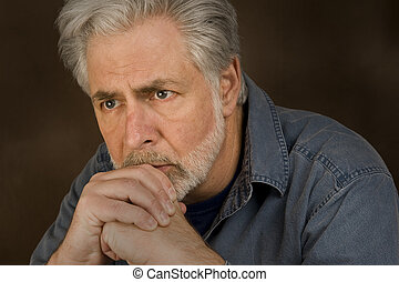 Deep Thought or Concern - A middle-aged man with gray hair...