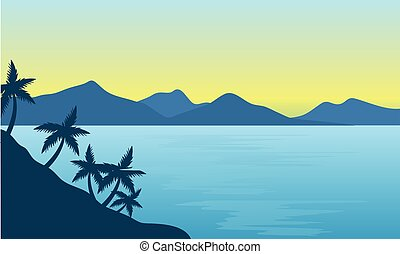 Silhouette of beach and hills background  at the morning