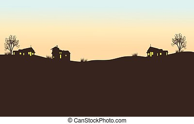 Silhouette of house in field