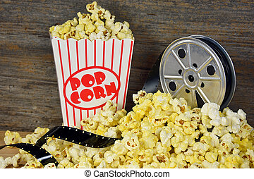 old movie reel with popcorn - Pile of popcorn with vintage...