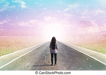 Back or rare of women standing on pavement road with dreamy...