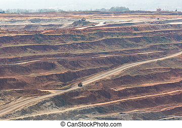 Mining dump trucks working in Lignite coalmine lampang...