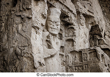 Porter's statue rock carving at Longmen Grottoes, Luoyang ,...