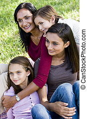 Family portrait, mother with three children - Interracial...