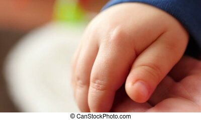Holding hand of baby