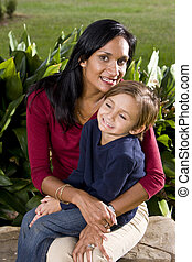 Mother with five year old son on lap