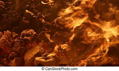 The burning coals in the furnace