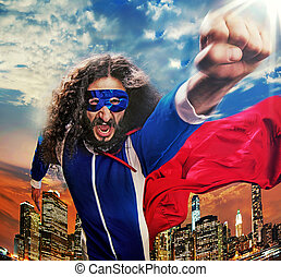 Portrait of a superhero wathcing over the city - Portrait of...