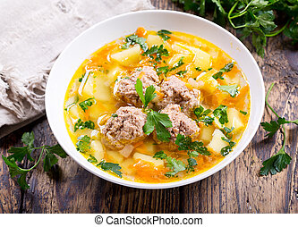 plate of soup with meatballs