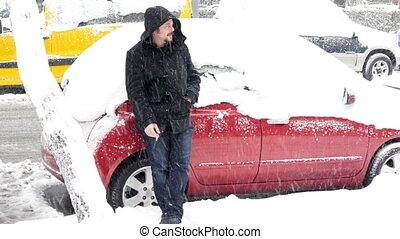 Helpless man waiting rescue, Car stuck under snow, snowy day...