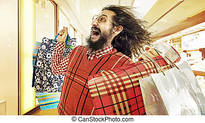 Funny image of geek guy during a sale madness - Funny image...
