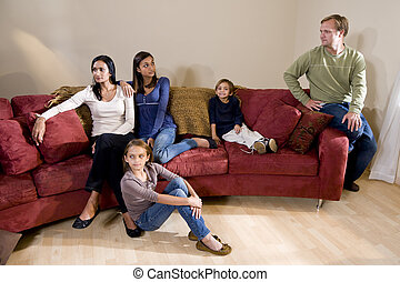 Family on couch, father and teen daughter having...