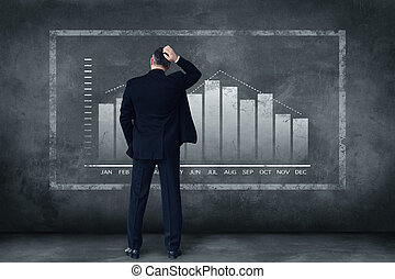 Hard decisions every day. Rear view of mature businessman scratching his head while standing against grey background with illustration of chart