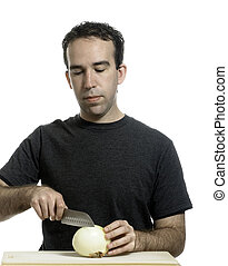 Man Cutting Onion - A young man cutting an onion with a...