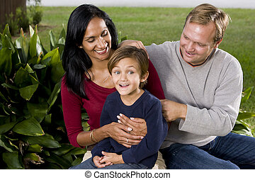 Interracial family with cute five year old boy - Interracial...