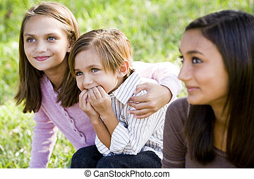 Three close siblings together outdoors on sunny day - Cute 5...