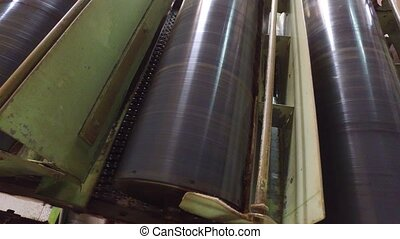 vintage machine conveyor rolls spinning at factory -...