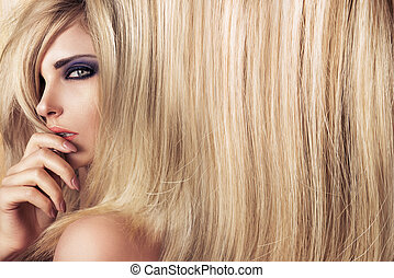 Closeup art portrait of a young model with long straight hair