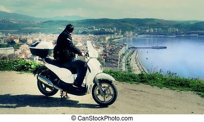"""Motorbike rider at Gemlik, Bursa, Turkey, High angle"""