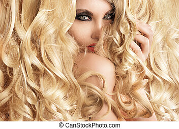 Beautiful lady with blond tumbling curls
