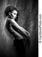 Fashion art photo of a beautiful girl in mixed light. black and white