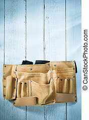 tool belt on wooden background