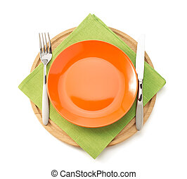 plate and fork with knife at napkin cloth on white...