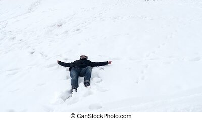 """Happy man lie down in snow, lying white background"""