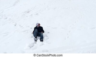 quot;Happy man lie down in snow, lying white backgroundquot;...