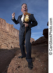 Businessman Riding a Stick Horse - A comical businessman is...