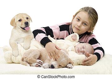 little girl hugging a newborn baby