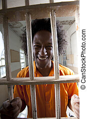 Happy Man in Prison Cell - Portrait of a male prisoner with...