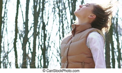 Beautiful girl jumping in a sunny spring forest. Slowly -...
