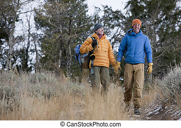 Happy Couple Hiking Together - Full length view of a couple...