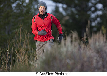 Man Hiking in the Wilderness - A man walks toward the camera...