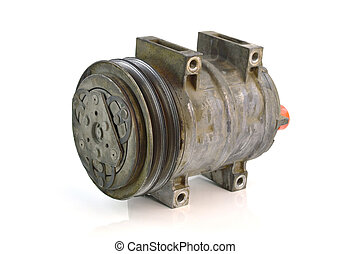 Automotive air conditioning compressor old on a white...